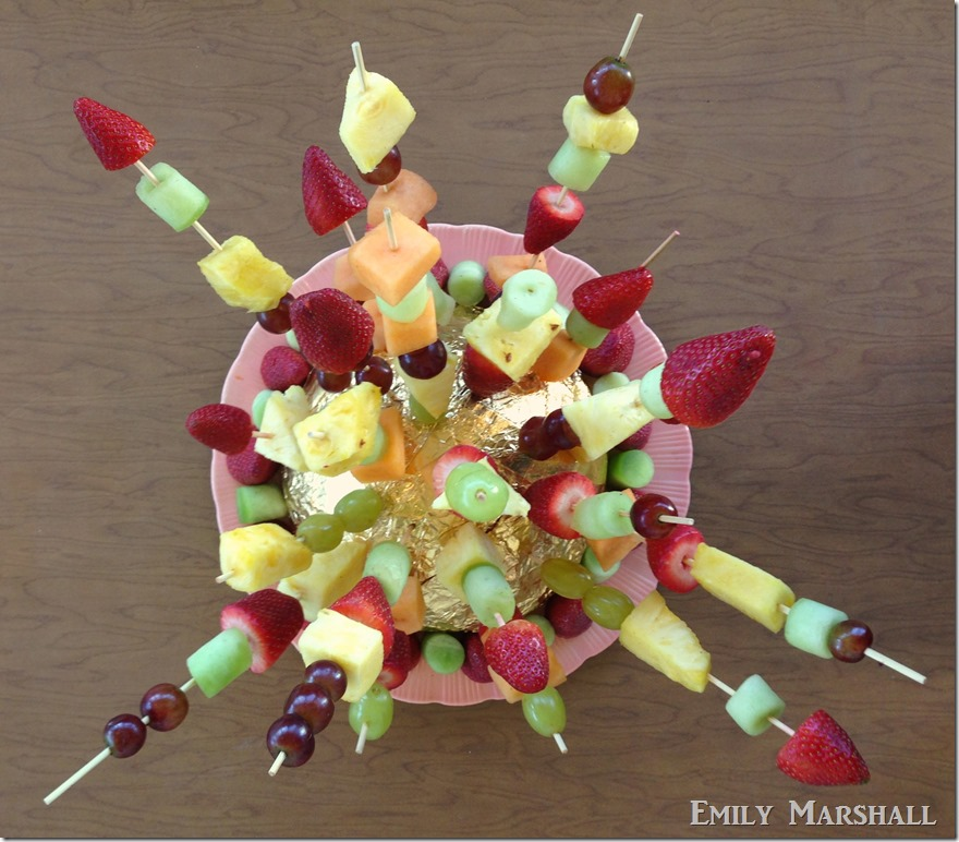 fruit skewers in astro glove